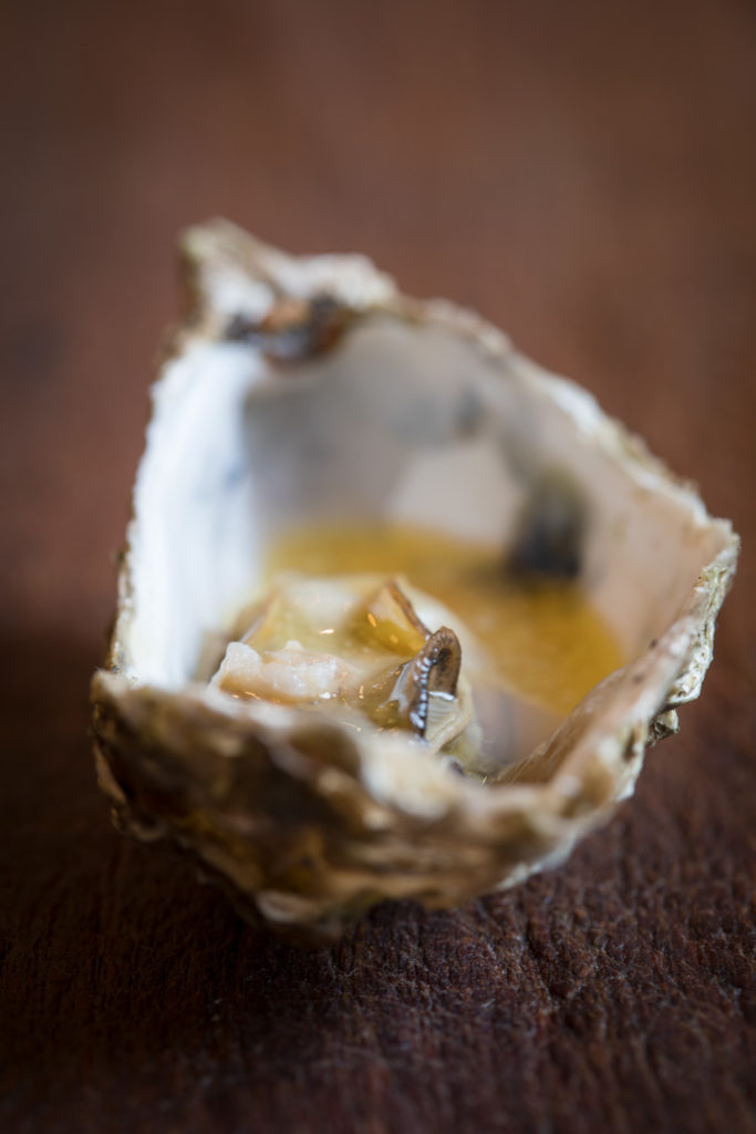 oyster with butter and pommeau