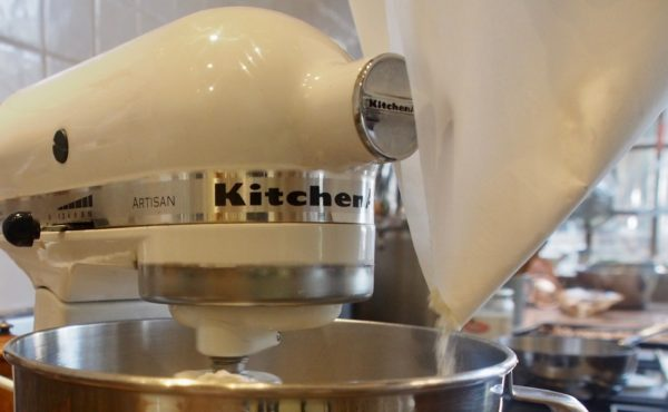 With the mixer running at slow speed, add the dry ingredients, mixing just until they are thoroughly incorporated. Don't over-mix the dough or the cookies will be tough.