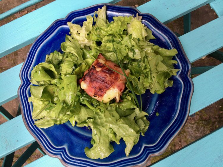 Grilled Bacon Wrapped Goat Cheese on Salad